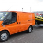 orange van and clidive yellow